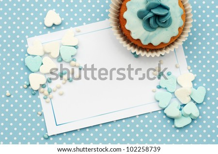 baby blue with candy hearts and cupcake card background - stock photo