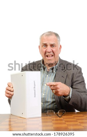 Baby-boomer businessman with annual report isolated on white - stock photo