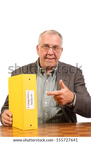 Baby-boomer businessman with competitive analysis report isolated on white - stock photo