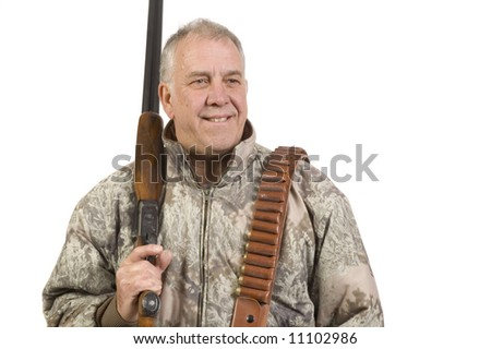 Baby- boomer Hunter with a double barreled side by side 20 gauge shotgun over shoulder and isolated on white - stock photo