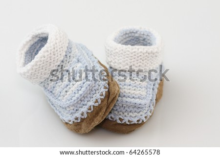 Baby Booties knitted our of yarn with sewn to leather.