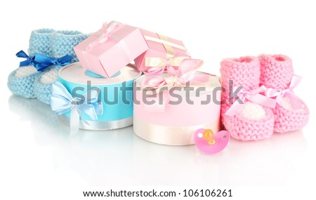 baby boots, pacifier, gifts and blank postcard  isolated on white - stock photo