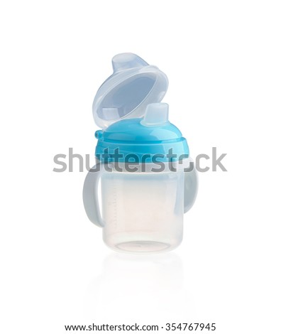 baby bottle, cup with handles isolated on white - stock photo