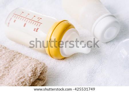 Baby bottle with milk - stock photo