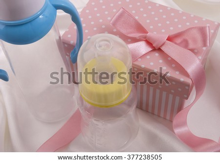 Baby bottles and box - stock photo