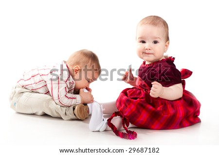 baby boy and baby girl playing together - stock photo