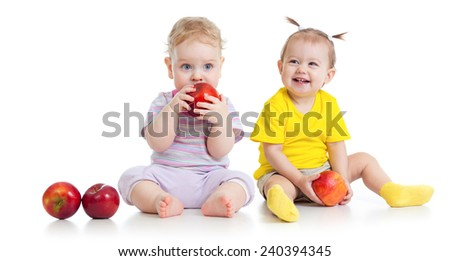 Baby boy and girl eating healthy food isolated - stock photo