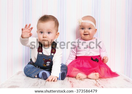 Baby boy and girl twins portrait - stock photo