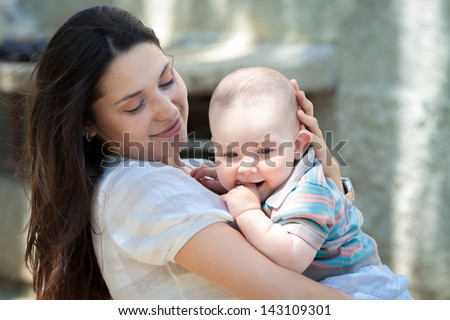 Baby boy and mom - stock photo