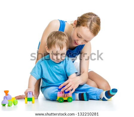 baby boy and mother play together - stock photo