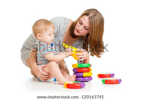 baby boy and mother playing together with construction set toy - stock photo