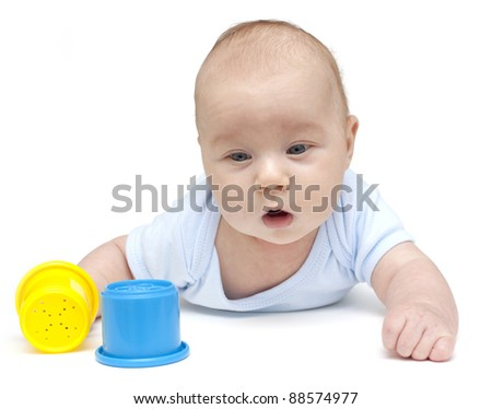 baby boy and toy cups isolated on white
