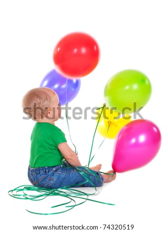 Baby boy celebrates his first birthday with colorful balloons - stock photo