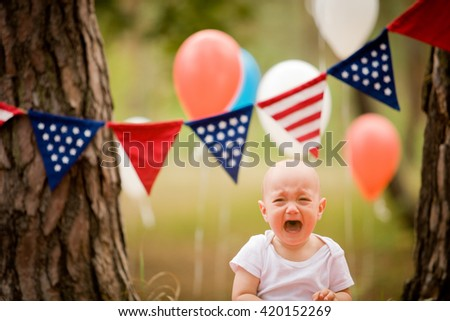 baby boy celebrating 4th july with american usa flag
