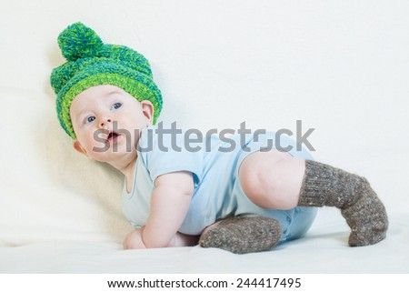 Baby boy clothes knitted cap warm socks. - stock photo