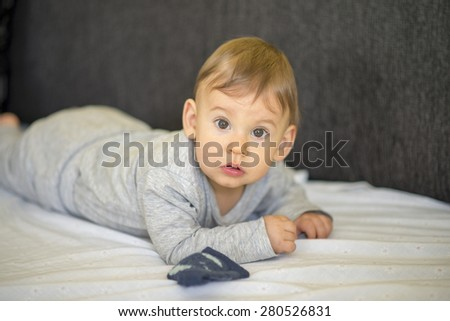 baby boy crawling in bed