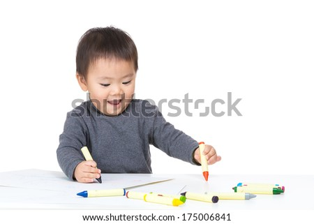Baby boy drawing with crayon - stock photo