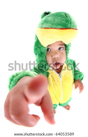 Baby boy dressed in a frog costume - stock photo