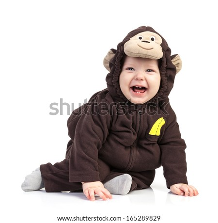Baby boy dressed in monkey costume over white - stock photo