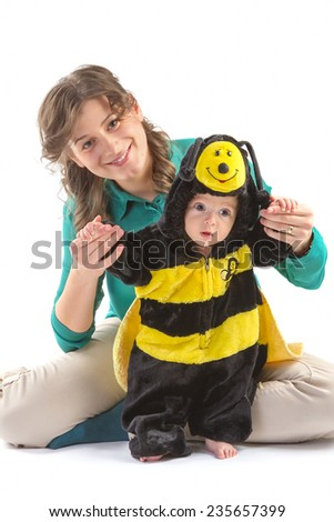 Baby boy dressed up like bee with his mother on white background - stock photo