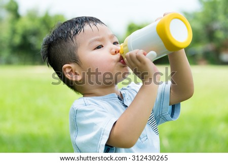 Baby boy drink with water bottle - stock photo
