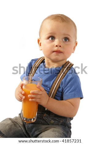 Baby boy drinking juice - stock photo