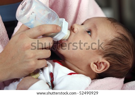 Baby boy drinking milk - stock photo