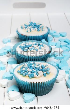baby boy Dutch biscuit cupcake - stock photo