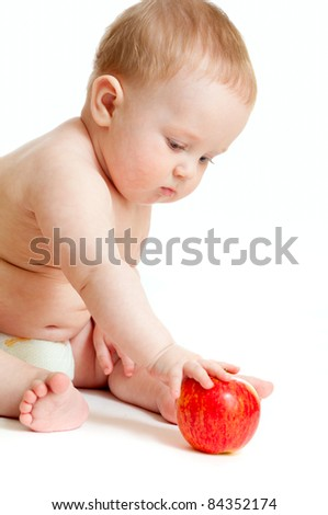 Baby boy eating healthy food isolated - stock photo