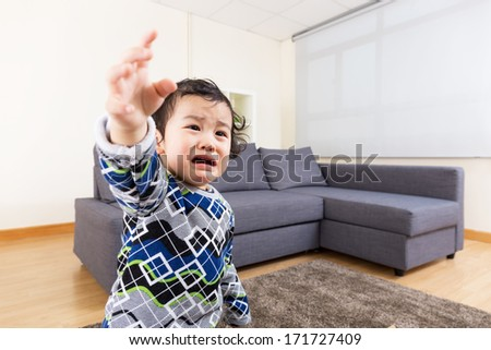 Baby boy feeling upset - stock photo