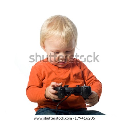 Baby boy holding a video game controller - stock photo