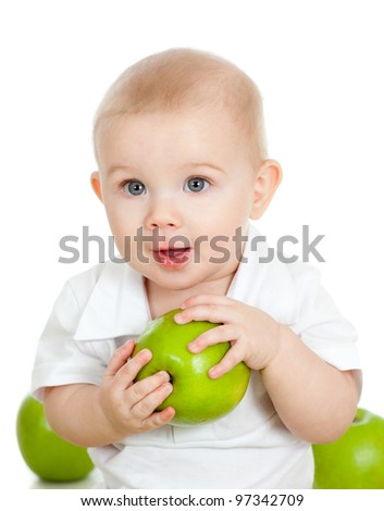 Baby boy holding and eating green apple, isolated on white - stock photo