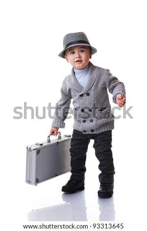 Baby boy holding silver suitcase. - stock photo