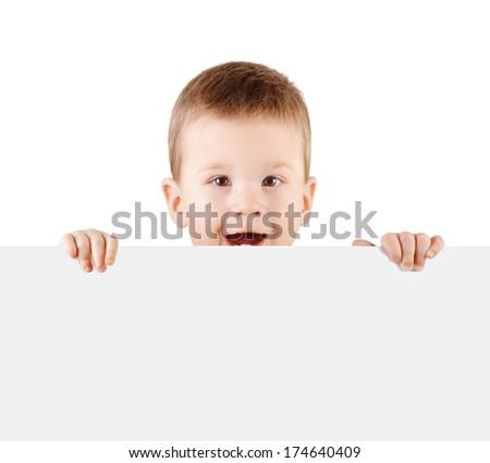 Baby boy holding white blank board isolated on white background - stock photo