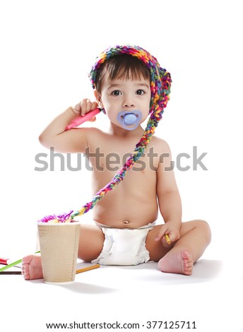 baby boy in a cap with felt pen - stock photo