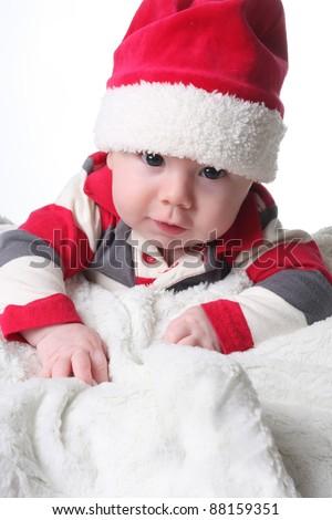 Baby boy in a Christmas Santa hat. - stock photo