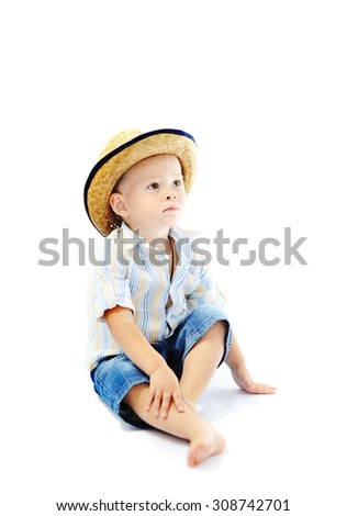 baby boy in a straw hat on a white background - stock photo