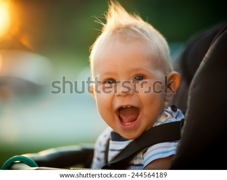 Baby Boy in a stroller - stock photo