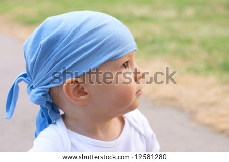 baby boy in bandanna - stock photo