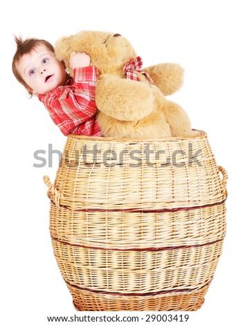Baby boy in basket with teddy bear - stock photo