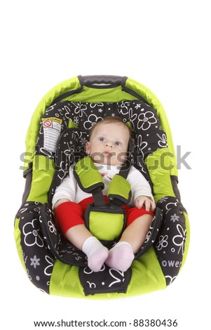 Baby boy  in car safety seat isolated on white background - stock photo