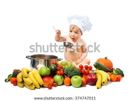 Baby boy in chef hat with cooking pan and vegetables