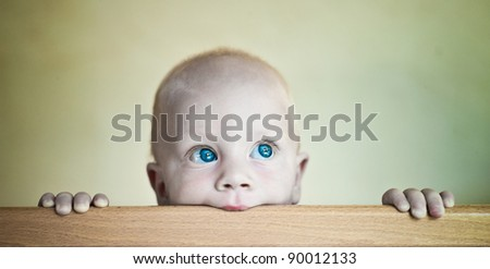 Baby Boy in crib - stock photo