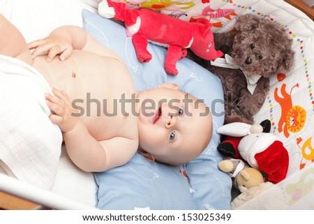 baby boy in diaper on white, blue eye - stock photo