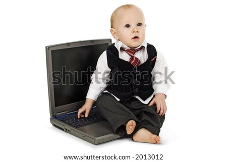 Baby boy in suit sitting on laptop.  Clipping path. Over white.