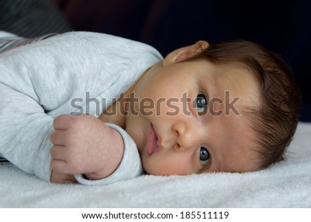 Baby boy laying down - stock photo