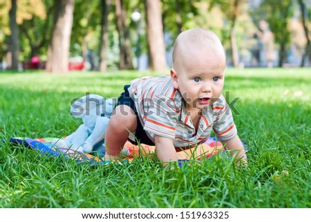Baby boy learning to crawl