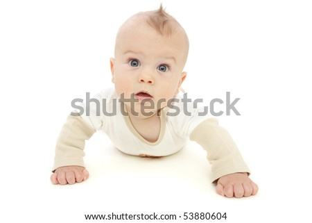 Baby boy looking at camera, surprised or curious, tummy time, on white background
