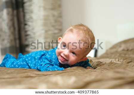baby boy lying on belly - stock photo