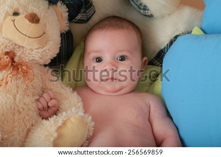 baby boy lying on his back in a diaper - stock photo